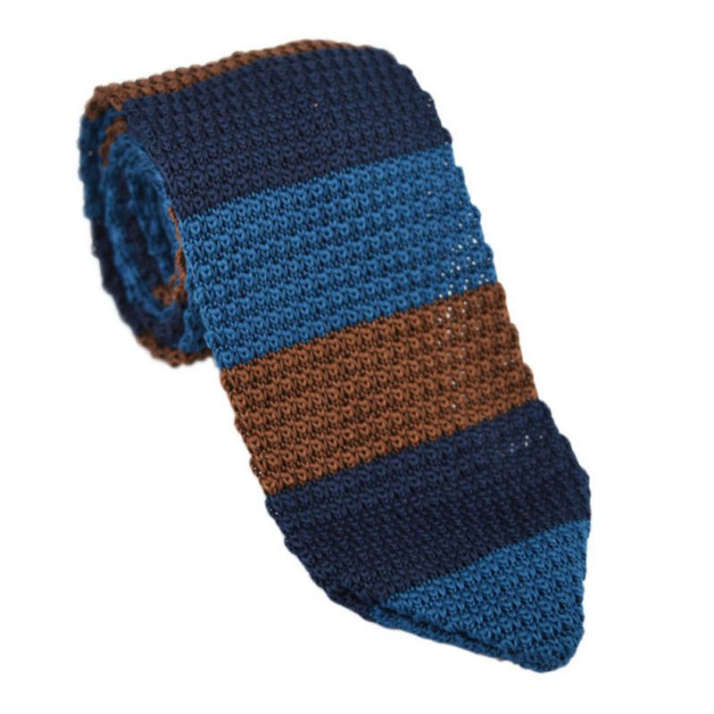Knit Ties. In a hearty rebound, the dependable and elegant knit tie has made a fashion comeback. Always the solid look in men's fashionable style, the knitted silk tie seemed to fade from the scene for a moment and is now back and more desirable than ever. The knit tie, forever popular in the s is famous for being flat at the bottom.