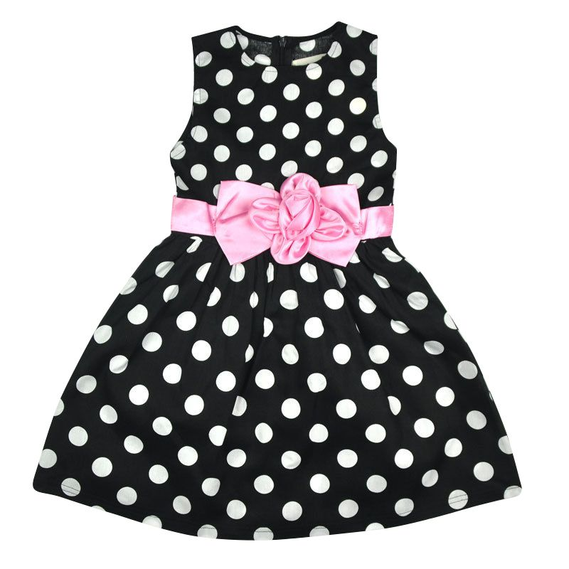Complete with a playful polka dot print, this full and flowy dress is perfect for any special occasion.